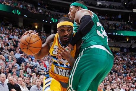 Denver's Ty Lawson squeezed past Paul Pierce's tight defense.